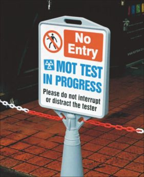 Do Not Interrupt the Tester Sign